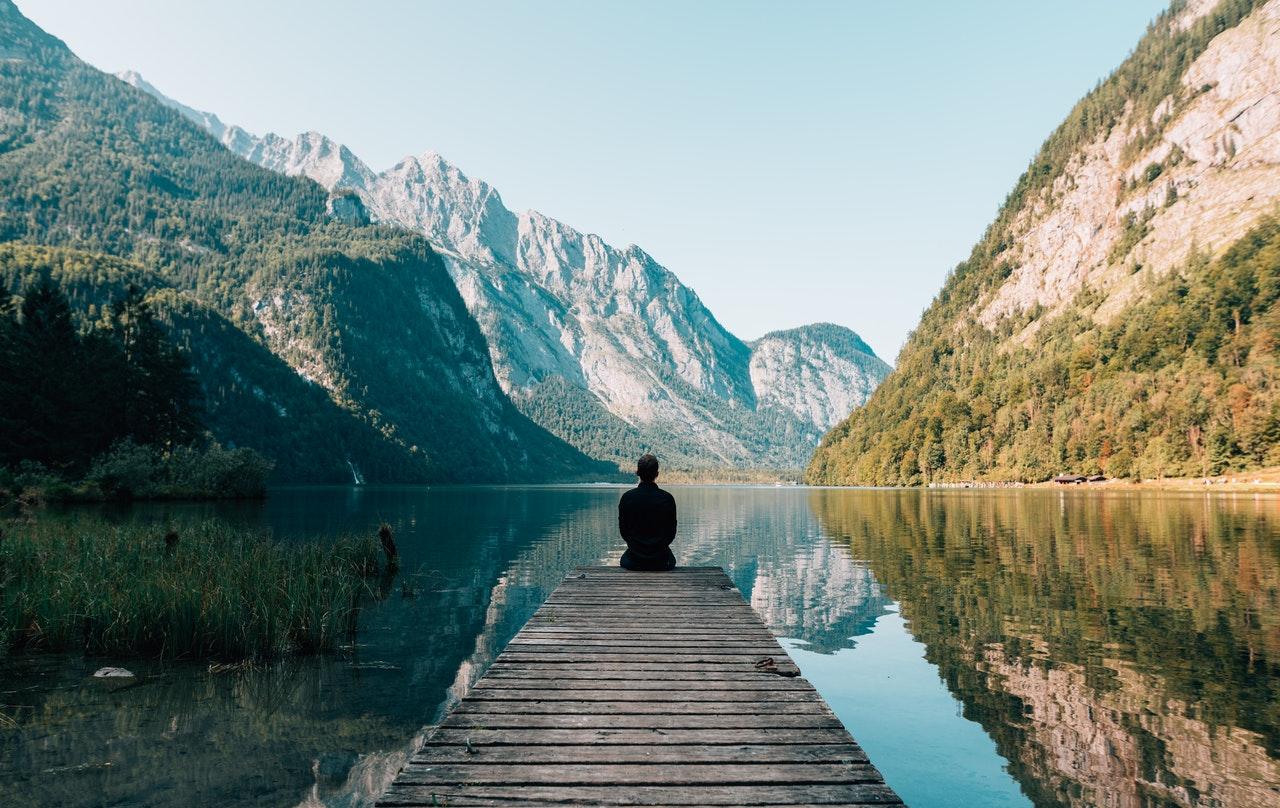 person-on-a-bridge-a-lake-pat-obrien-ventures
